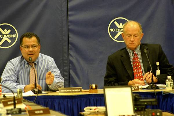 Park Ridge-Niles School District 64 Superintendent Philip Bender, right, listens as school board president Anthony Borrelli addresses the audience at the September 9 school board meeting.