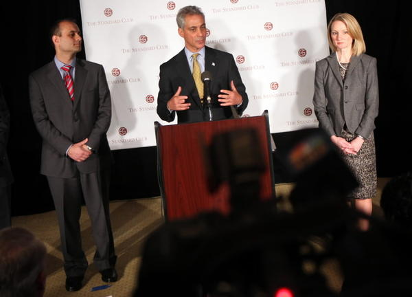 Mayor Rahm Emanuel, seen here in 2011 with now-indicted former comptroller, Amer Ahmad, left and CFO Lois Scott, right, gave Scott a vote of confidence today.