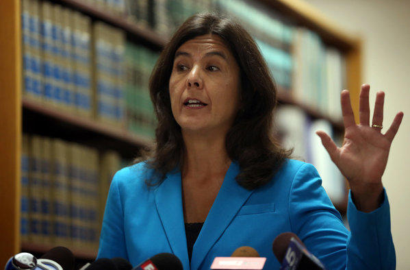 Cook County State's Attorney Anita Alvarez announces that her office is dismissing criminal charges against two imprisoned Chicago men following a re-investigation of their cases.
