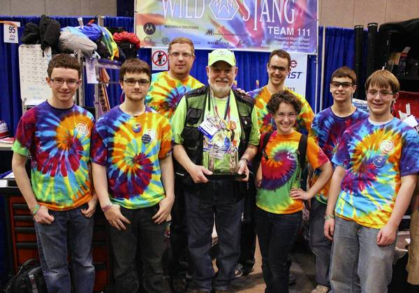 In the WildStang pit with, from left, Nathan Walters, Joey Bartlett, Kevin Kovac, Al Skierkiewicz, Steve Garward, Jacki Rohde, Mike Lipinski, Teddy Reimann when he received his Volunteer of the Year Award from FIRST (For Inspiration and Recognition of Science and Technology).