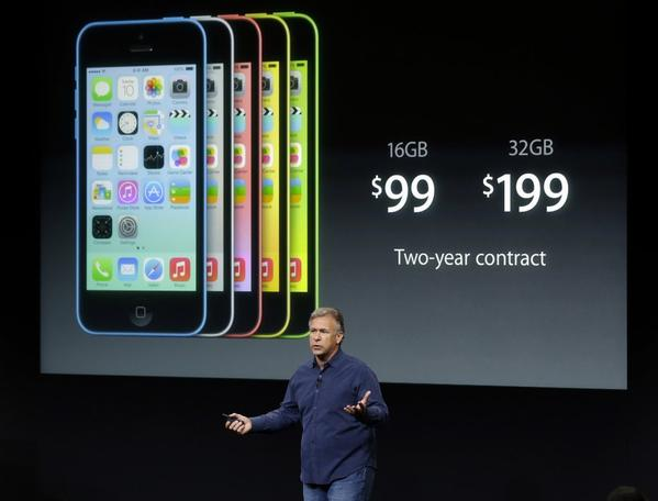 Phil Schiller, Apple's senior vice president of worldwide product marketing, speaks on stage during the introduction of the new iPhone 5c in Cupertino, Calif., on Tuesday.