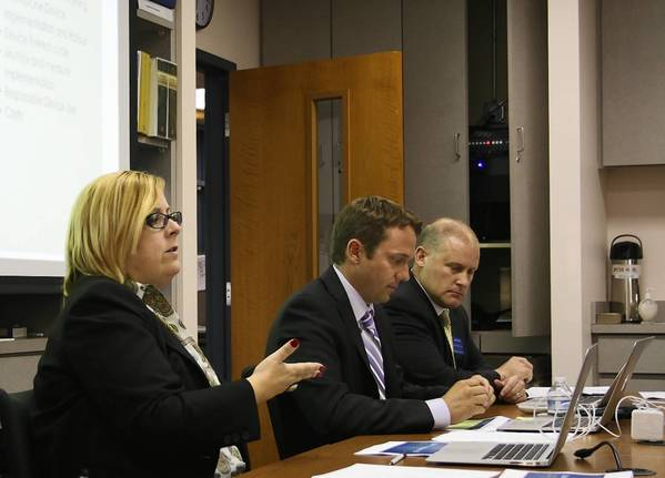 Lynn Zeder, director of curriculum, instruction and assessment, goes over plans for a technology taskforce Monday with the Orland School District 135 board. To her right are technology coordinator Dan Doogan, center, and Dave Snyder, assistant director of curriculum.