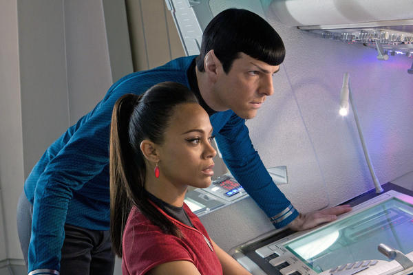 "(Left to right) Zoe Saldana is Uhura and Zachary Quinto is Spock in ""Star Trek into Darkness."""