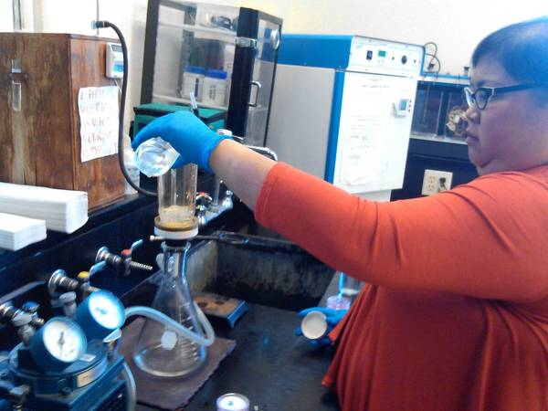 Marianne Evangelista, Highland Park's water plant chemist, demonstrates the membrane filtration water testing method. There are faster methods to confirm contamination, she said, but this method provides more information on the number of bacteria detected.