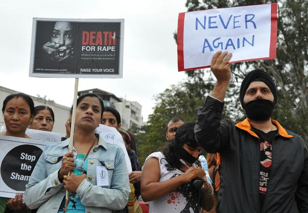 Indian protesters hold a demonstration in Bangalore in December after the death of a woman who was gang-raped in New Delhi.