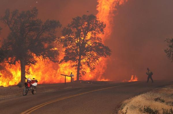 The Clover fire began Monday. Above, the blaze in Anderson, Calif.