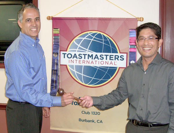 Burbank Toastmasters incoming President Ric Duran, left, receives the gavel from President Gary Monji.