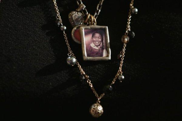 Diane Robertson Braddock wears a necklace with the image of her sister, Carole Robertson, one of four young girls killed in the 1963 16th Street Baptist Church bombing. The children received the Congressional Gold Medals in a ceremony at the U.S. Capitol.