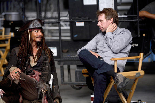"Actor Johnny Depp, left, and producer Jerry Bruckheimer on the set of the 2007 movie ""Pirates of the Caribbean: At World's End."""
