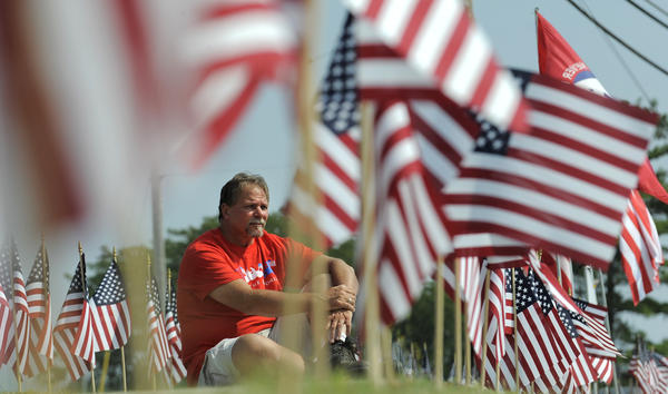 "Chuck Ritz is the organizer of the ""Path of Honor"" which has been created using 2977 flags, one for every person who died in the attacks on 9/11. The flags are located along Putty Hill Avenue in Parkville."