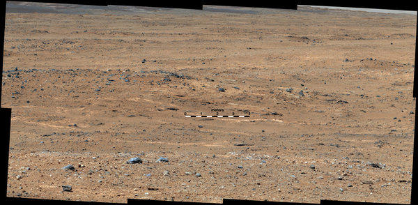 An outcrop visible as light-toned streaks in the lower center of this image has been chosen as a place for NASA's Mars rover Curiosity to study for a few days this month.