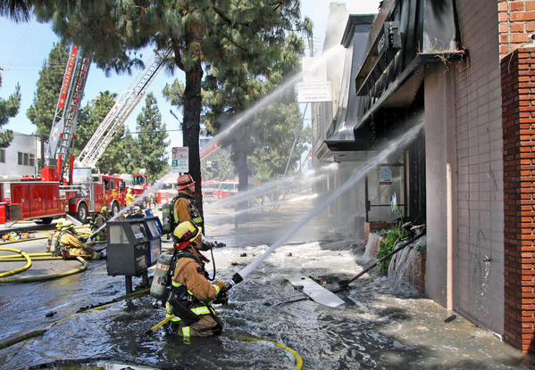 Firefighters battle a blaze at a carpet store in the 100 block of South Glenoaks Blvd. in Burbank on Monday, May 27, 2013. Burbank Fire Department is set to receive a new radio system.