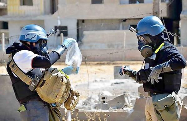 U.N. inspectors collect samples outside Damascus last month after an alleged chemical attack. Russia's proposal to put Syria's chemical weapons stockpile under international control for dismantling would be extremely difficult to carry out, experts said.