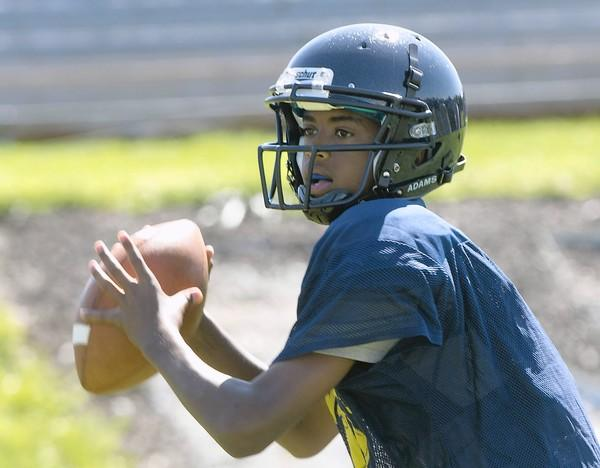 Notre Dame High School quarterback Kordell Theadford, 17, of Easton, prepares to pass during football practice on Thursday, August 15, 2013.