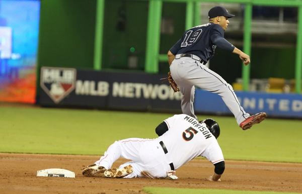 Atlanta Braves shortstop Andrenlton Simmons is out at second base, as Miami Marlins first baseman Logan Morrison is unable to complete a double play in the first inning at Marlins Stadium in Miami, Florida, on Tuesday, September 10, 2013. (Hector Gabino/El Nuevo Herald/MCT)