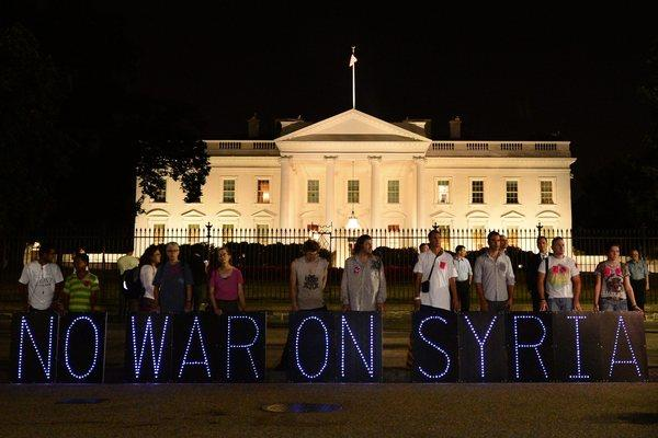 Opponents of a possible military strike against Syria demonstrate outside the White House on Tuesday.