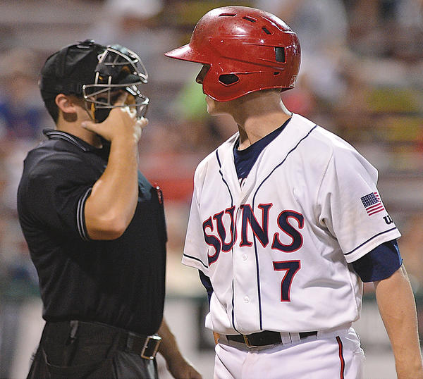 Hagerstown's Tony Renda lets home plate umpire Jordan Albarado know his opinion of a called third strike Tuesday during the Suns' 6-2 loss to Savannah in Game 2 of the South Atlantic League championship series.