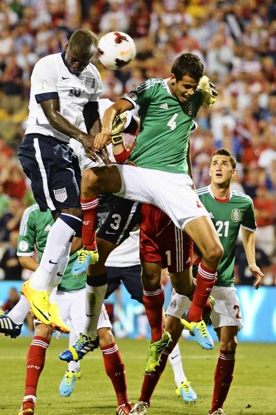 Eddie Johnson (18) of the United States Men's National Team heads the ball past Diego Reyes of the Mexico Men's National Team in the second half for a goal off a corner kick at Columbus Crew Stadium in Columbus, Ohio, on Tuesday night. The United States defeated Mexico 2-0.