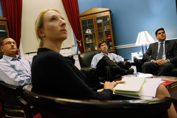 Rep. Brad Schneider, D-Ill., second from right, watches from his congressional office Tuesday as President Barack Obama gives a televised address about proposed military action against Syria.