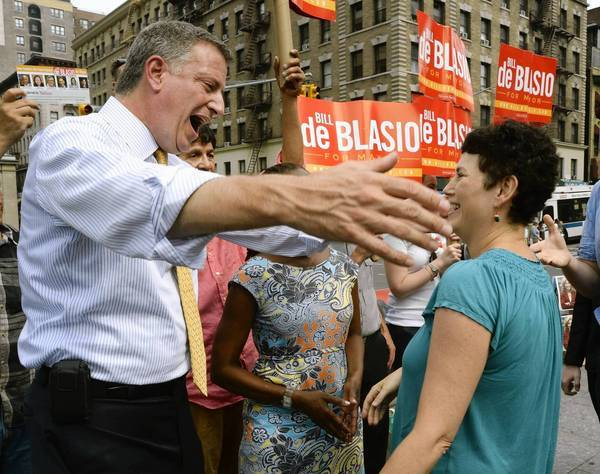 Bill de Blasio greets voters in Manhattan during the primary vote to choose New York's Democratic candidate for mayor.