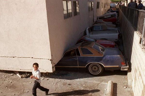 Crushed vehicles at the Northridge Meadows apartment complex on Jan. 17, 1994, the day of the Northridge earthquake. Sixteen residents were killed in the magnitude 6.7 temblor.