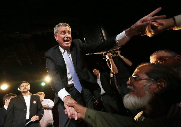 Bill de Blasio, winner of New York's Democratic mayoral primary, greets well-wishers at his victory party in Brooklyn.