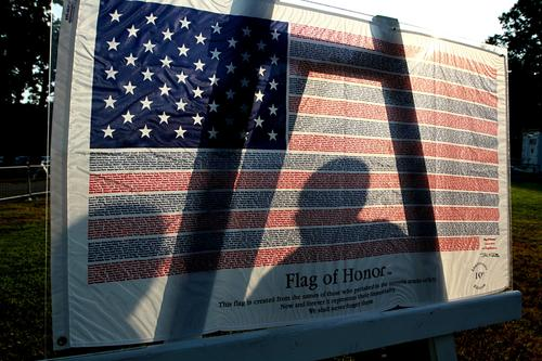Day of Remembrance and Hope at Gosnold's Hope Park for 911.  This flag hopes the names of the fallen in 911.