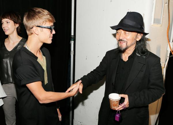 Justin Bieber, left, meets fashion designer Yohji Yamamoto backstage at the Y-3 Spring/Summer 2014 show during Mercedes-Benz Fashion Week in New York City.