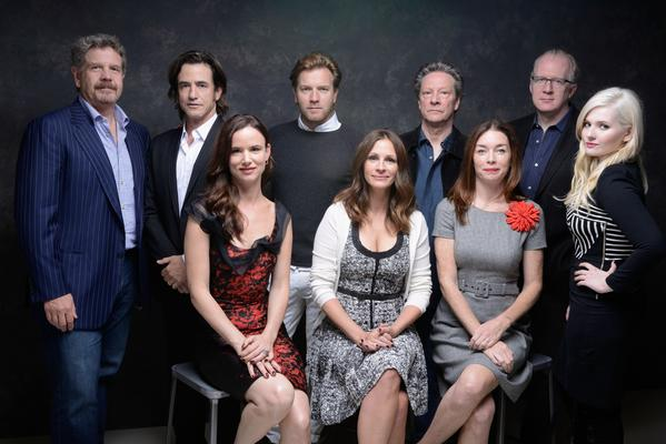 "Director John Wells, left, actor Dermot Mulroney, actress Juliette Lewis, actor Ewan McGregor, actress Julia Roberts, actor Chris Cooper, actress Julianne Nicholson, screenwriter Tracy Letts and actress Abigail Breslin of ""August: Osage County."""