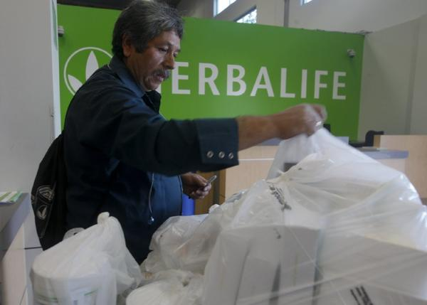 Herbalife distributor Jaime Ayala picks up some products at a distribution center in Carson earlier this year.