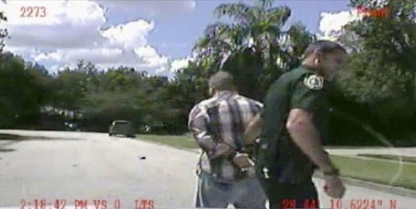 In this still image made from dash-cam video provided by the Lake Mary (Fla.) police, George Zimmerman is detained by officers on Monday. Police have been focusing on a broken iPad in their investigation of a domestic dispute between George Zimmerman and his estranged wife Shellie this week.