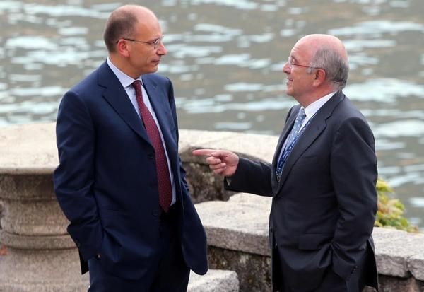 Italian Prime Minister Enrico Letta, left, chats with Joaquim Almunia, European commissioner for competition, at the annual global and economic get-together at the Villa d'Este on Italy's Lake Como.