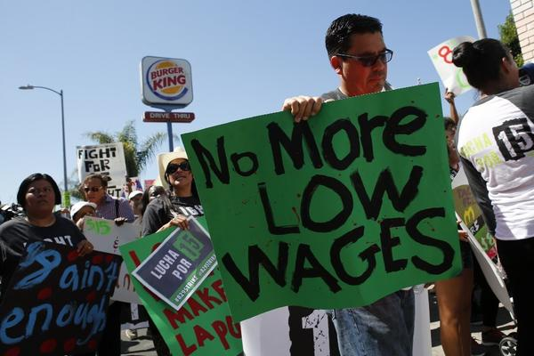 Fast-food workers protest for higher wages in Los Angeles in August. The state added jobs in transportation and utilities as well as professional and business services last month.