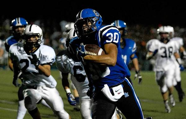 FILE PHOTO: Lake Zurich's Ben Klett runs toward the end zone Friday after catching a pass against Cary-Grove.