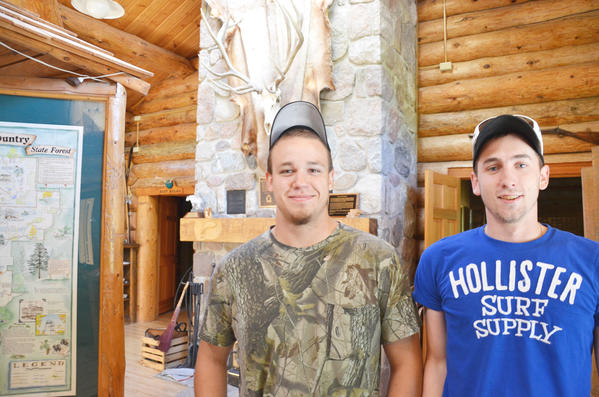 Jacob Clute (left) and Travis Kirby, both of Gaylord, were camping recently in the Pigeon River Country State Forest and had a cow elk and her calf within yards of their campsite. They were at the forest headquarters looking for more places to camp.