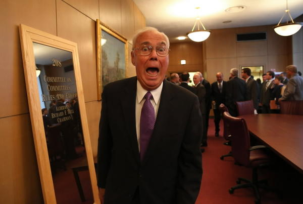 Former Alderman Dick Mell walks through the ante room outside council chambers giving a photographer a funny face in July.