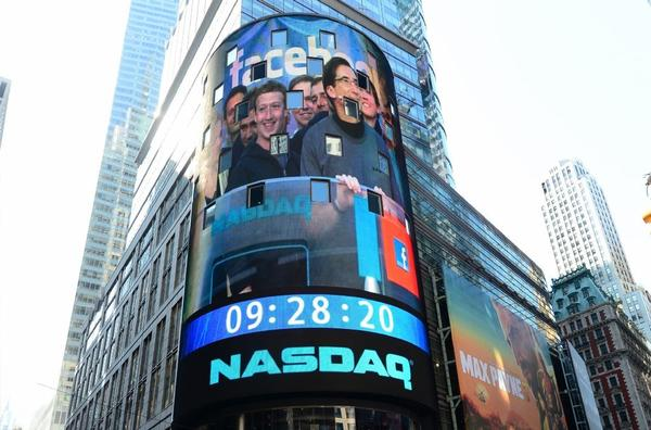 Facebook Chief Executive Mark Zuckerberg is seen on a screen in New York's Times Square getting ready to ring the NASDAQ stock exchange opening bell on May 18, 2012, the day Facebook stock first hit the market. On Wednesday, Facebook stock exceeded $45 a share for the first time.