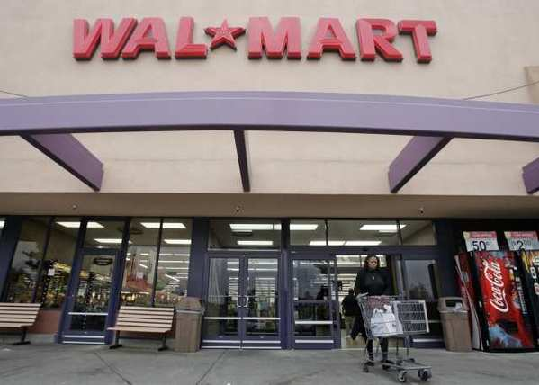 A customer leaves a Wal-Mart store in Mountain View, Calif. The California Legislature is close to passing a bill to raise the minimum wage for workers by $2 an hour over two years.