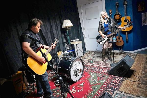 "Bobbo and Tracy Byrnes of the Fallen Stars jam at their recording studio in Westminster. The pair will be performing songs based on the sci-fi show ""Firely"" during the ""Can't Stop the Serenity"" benefit to support Equality Now, which takes place on Sept. 21."