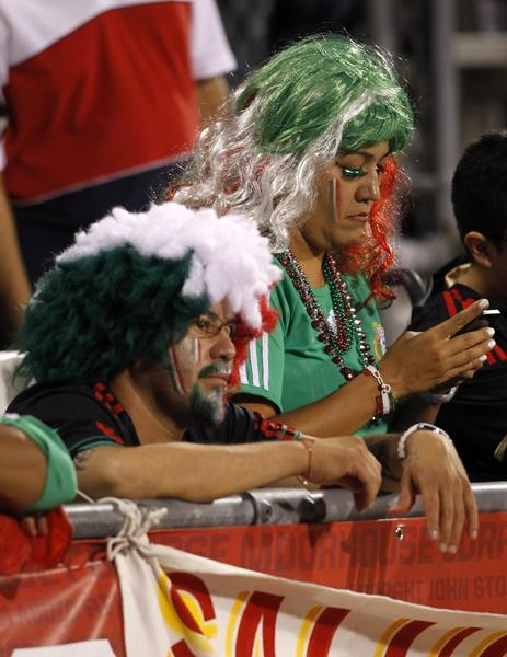 Mexico fans watch the final minutes of the second half of the Brazil 2014 FIFA World Cup qualifier against USA at Columbus Crew Stadium in Columbus, Ohio, September 10, 2013. USA won 2-0. AFP PHOTO / PAUL VERNONPaul VERNON/AFP/Getty Images ORG XMIT: 164989096