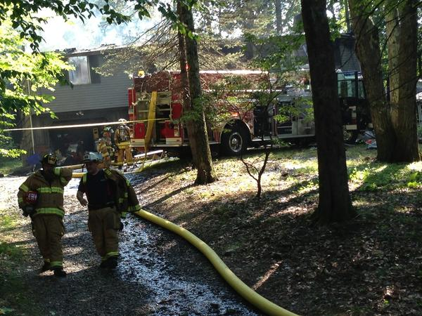 Firefighters at the scene of a fire on White Birch Drive in Tolland Wednesday afternoon.