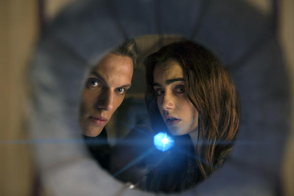"Jamie Campbell Bower as Jace, left, and Lily Collins as Clary in a scene from ""The Mortal Instruments: City of Bones."""