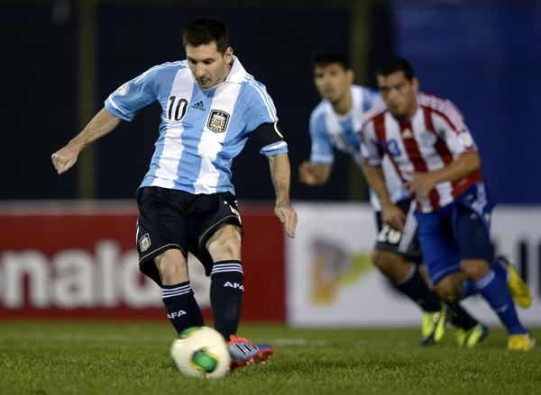 TOPSHOTS Argentina's forward Lionel Messi shoots a penalty kick to score against Paraguay during a Brazil 2014 FIFA World Cup South American qualifier football match at Defensores del Chaco stadium in Asuncion, Paraguay, on September 10, 2013.