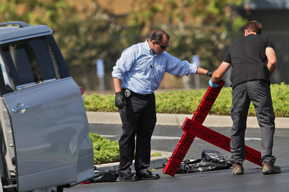 A former Transportation Security Administration screener suspected of making threats to terminals at Los Angeles International Airport was arrested just before midnight while sitting in a van that was parked at the Harvest Church, at Urban Street and Arlington Avenue in Riverside. FBI and Riverside police investigators gather evidence from the van and around it on Wednesday morning.