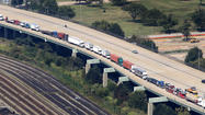 Pictures: Threat slows tunnel traffic