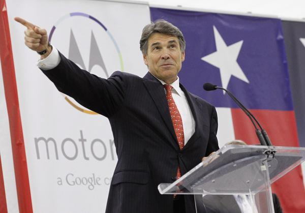"Texas Governor Rick Perry speaks at the Flextronics plant that will be building the new Motorola smartphone ""Moto X"" in Fort Worth, Texas September 10, 2013. The factory is a high-profile endorsement for ""onshoring"" manufacturing in the U.S."