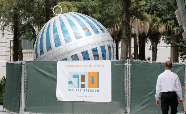 A new sculpture has been installed in front of the Orange County Regional History Center in downtown Orlando. It is obscured by a construction fence until its unveiling in November.