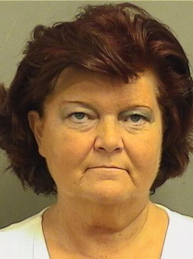 Sally Arlene Berry, 57, of Deerfield Beach, is accused of scamming four people out of a total of $107,000 after getting them to invest in a toilet air purifier.
