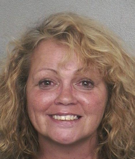 Lisa Andryshak, 49, is accused of stabbing neighbor Ken Davis in the back