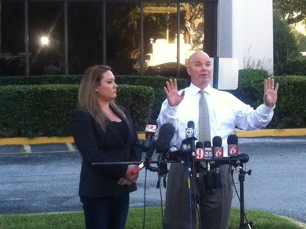 Shellie Zimmerman listens as her attorney Kelly Sims speaks during a press conference.